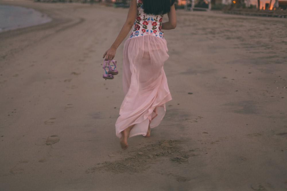 pink dress samantha de reviziis running on beach sharq village